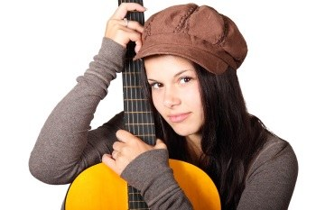young woman with acoustic guitar