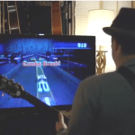 man in hat plays rocksmith