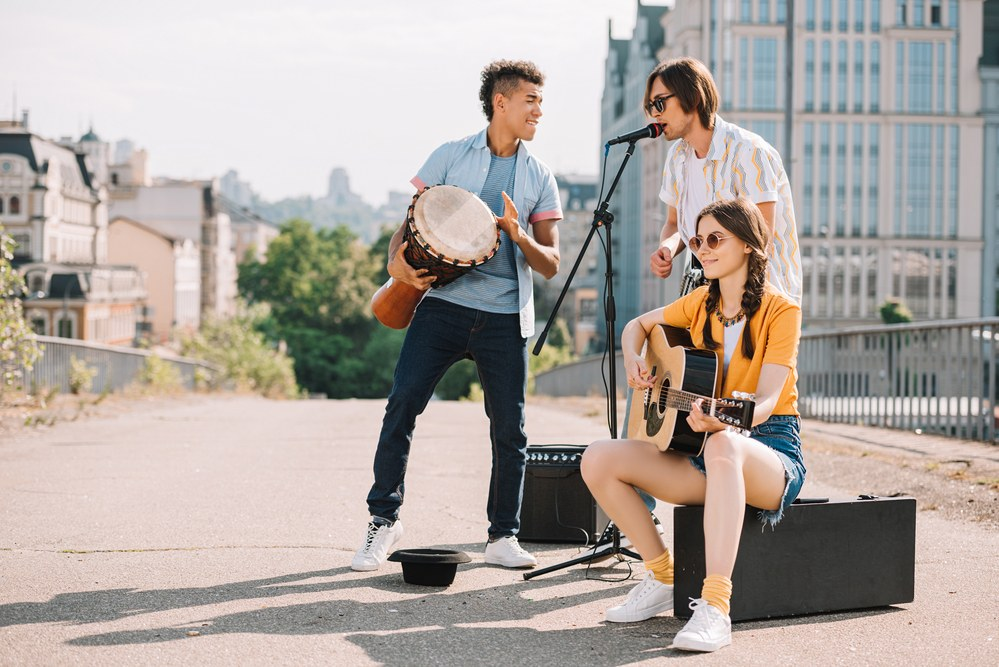 image of three friends playing an outdoor gig